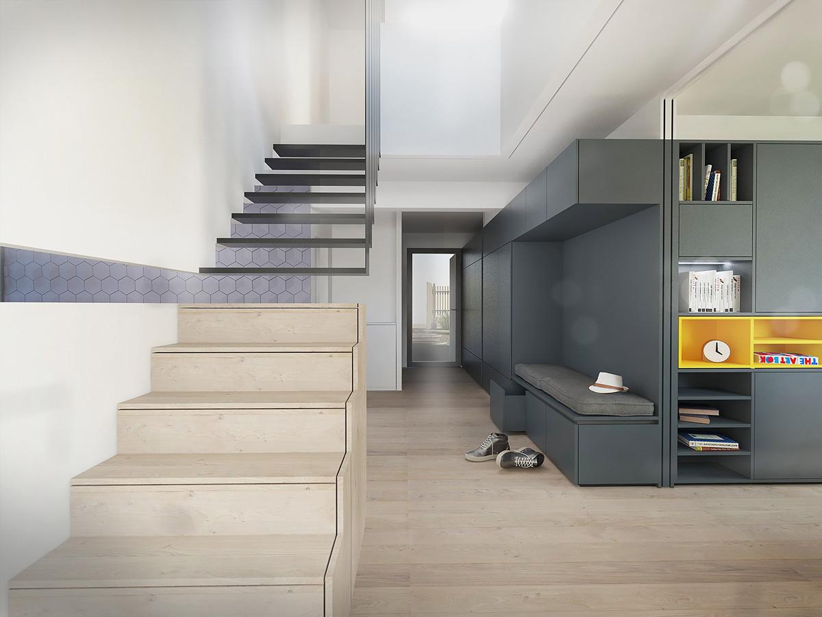 Rénovation et extension contemporaine d'une maison à Caluire de type verrière d'atelier, vue intérieure de l'escalier.