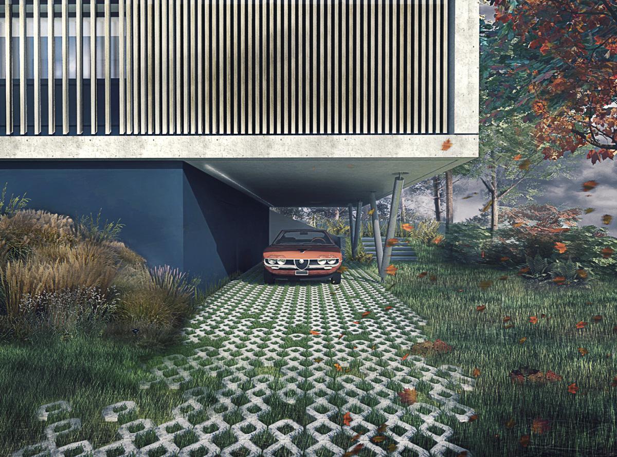 Maison contemporaine à Caluire en béton, sur un terrain en pente. Cadre en béton banché en porte à faux avec abri voiture dessous.