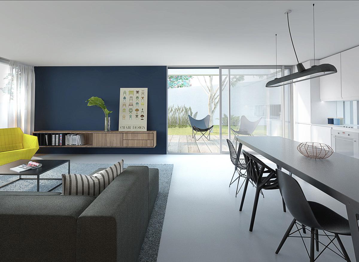 Maison contemporaine à Caluire en béton, sur un terrain en pente. Intérieur minimaliste et épuré, mur bleu et mobiliers scandinave.