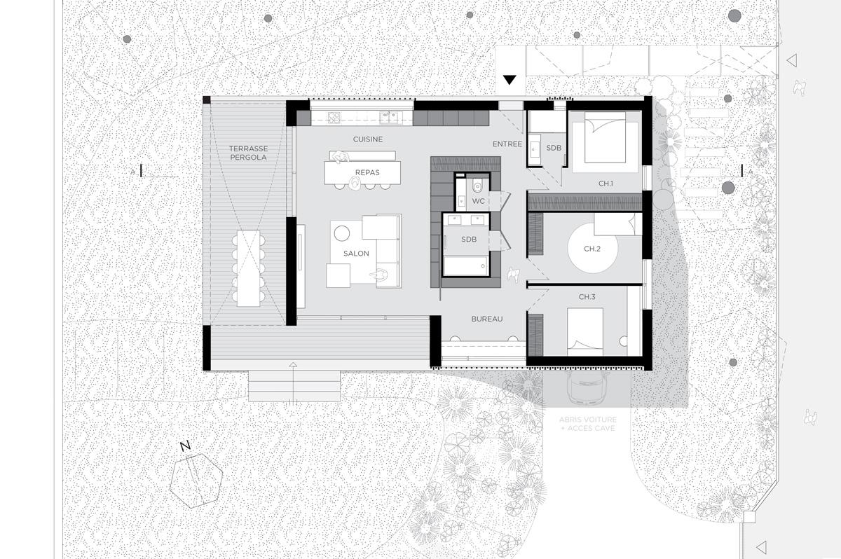 Maison contemporaine à Caluire en béton, sur un terrain en pente. Plan architecte rectangulaire.